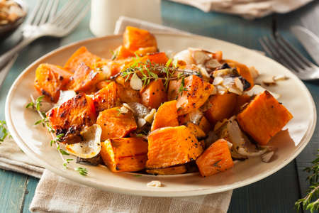 Homemade Cooked Sweet Potato with Onions and Herbs Stock Photo