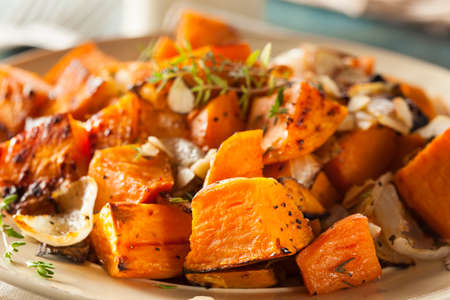 baked potatoes: Homemade Cooked Sweet Potato with Onions and Herbs Stock Photo