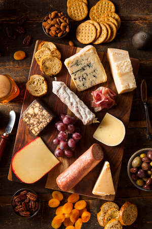 cheese platter: Fancy Meat and Cheeseboard with Fruit as an Appetizer Stock Photo