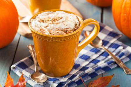 latte: Autumn Pumpkin Spice Latte with Milk and Cream Stock Photo