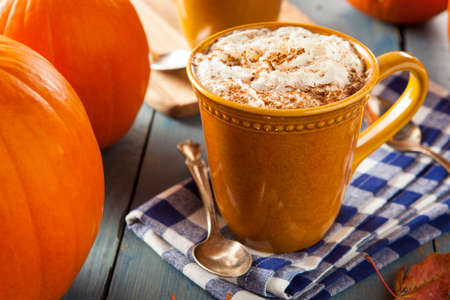 Autumn Pumpkin Spice Latte with Milk and Cream Stock Photo