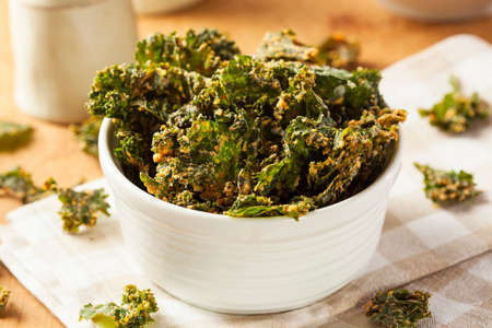 kale: Homemade Green Kale Chips with Vegan Cheese Stock Photo