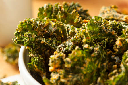 Homemade Green Kale Chips with Vegan Cheese 写真素材
