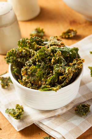 Homemade Green Kale Chips with Vegan Cheese Stock Photo