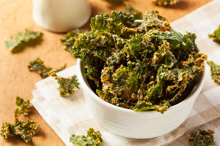 Homemade Green Kale Chips with Vegan Cheese Archivio Fotografico