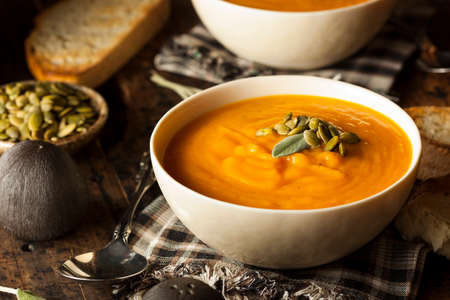 squash: Homemade Autumn Butternut Squash Soup with Bread Stock Photo