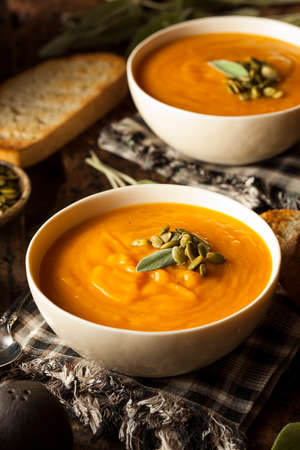 butternut squash: Homemade Autumn Butternut Squash Soup with Bread Stock Photo