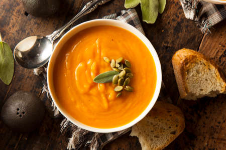 Homemade Autumn Butternut Squash Soup with Bread Stock Photo