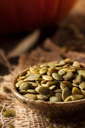 pumpkin seeds: Raw Organic Pumpkin Pepita Seeds in a Bowl Stock Photo