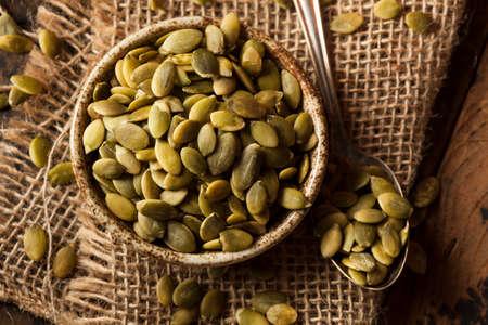 Raw Organic Pumpkin Pepita Seeds in a Bowl Stok Fotoğraf