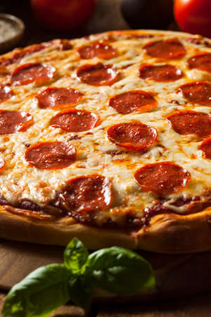 sliced cheese: Hot Homemade Pepperoni Pizza Ready to Eat Stock Photo