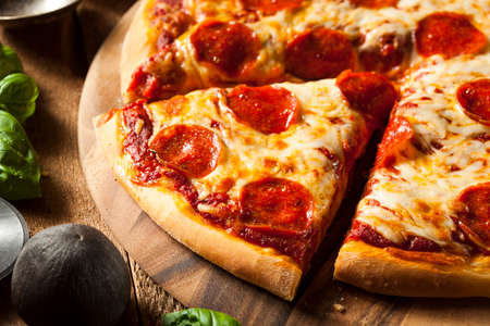 pizza slice: Hot Homemade Pepperoni Pizza Ready to Eat Stock Photo