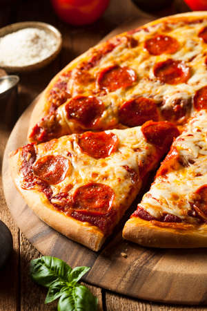 melted cheese: Hot Homemade Pepperoni Pizza Ready to Eat Stock Photo