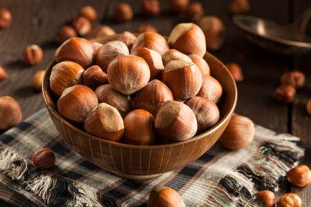 Raw Organic Whole Hazelnuts in a Bowl Stock Photo
