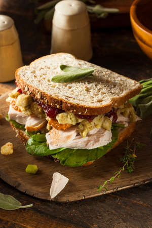 fresh bakery: Homemade Leftover Thanksgiving Dinner Turkey Sandwich with Cranberries and Stuffing Stock Photo