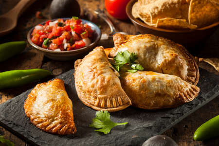 minced pie: Homemade Stuffed Chicken Empanadas on a Background Stock Photo