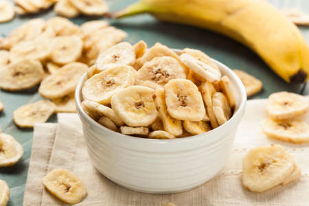 Homemade Dehydrated Banana Chips in a Bowl Stock Photo