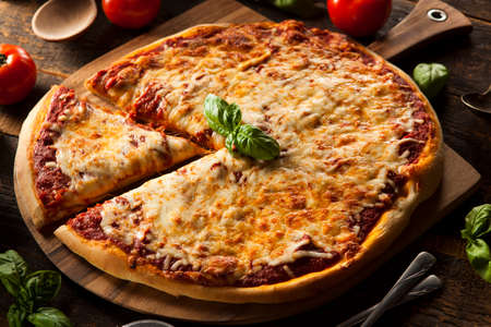 pies: Homemade Hot Cheese Pizza with Basil and Mozzarella Stock Photo