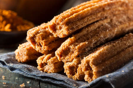 fritter: Homemade Deep Fried Churros with Cinnamon and Sugar Stock Photo