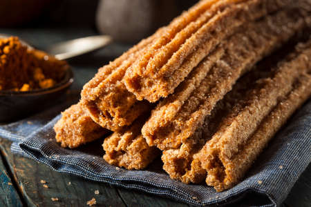 churros: Homemade Deep Fried Churros with Cinnamon and Sugar Stock Photo