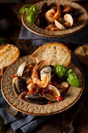 Homemade Italian Seafood Cioppino with Mussels, Clams, and Shrimps photo