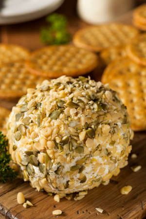 crackers: Homemade Cheeseball with Nuts and Wheat Crackers Stock Photo