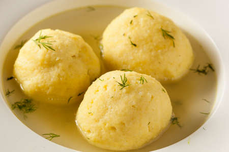jewish food: Hot Homemade Matzo Ball Soup in a Bowl
