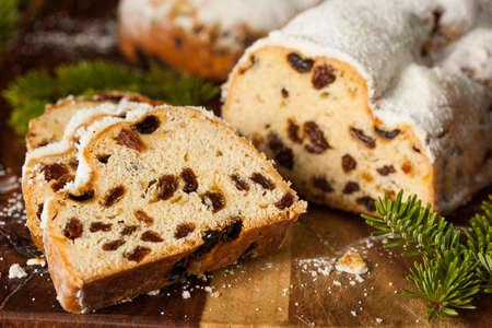 Festive Christmas German Stollen Bread with Powdered Sugar photo