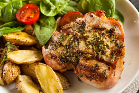 pork chop: Large Grilled Pork Chop with Basil Lemon Seasonings