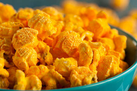 bowl of popcorn: Homemade Cheddar Cheese Popcorn in a Bowl