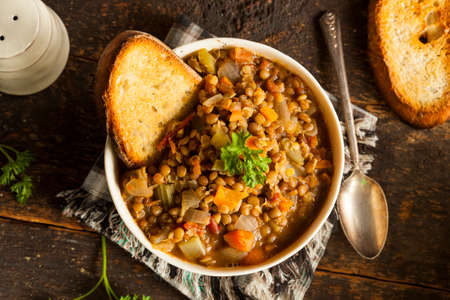 beans soup: Homemade Brown Lentil Soup with Carrots Onions and Tomatos