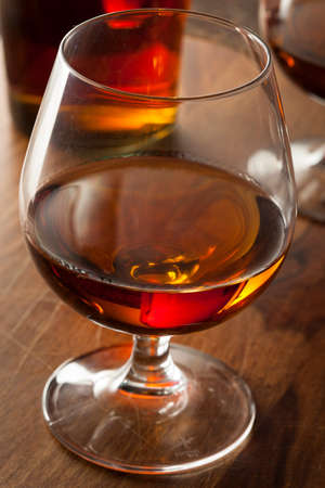 distilled alcohol: Amber Brandy in a Glass Ready to Drink Stock Photo