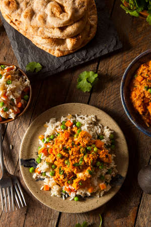 Homemade Chicken Tikka Masala with Rice and Naan photo