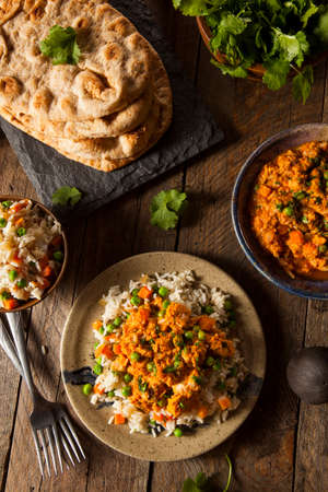 india food: Homemade Chicken Tikka Masala with Rice and Naan