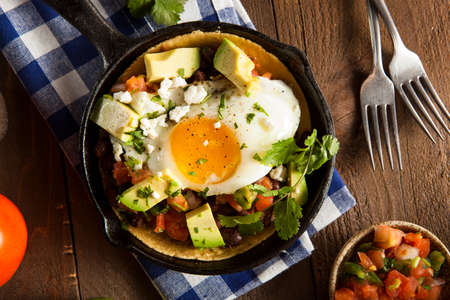 breakfast plate: Homemade Heuvos Rancheros with Avocado and Cilantro
