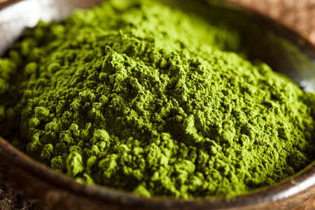green and white: Raw Organic Green Matcha Tea in a Bowl