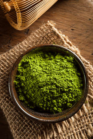dry powder: Raw Organic Green Matcha Tea in a Bowl
