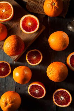 Organic Raw Red Blood Oranges on a Background