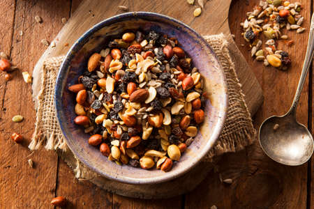 Raw Organic Homemade Trail Mix with Nuts and Fruits Imagens