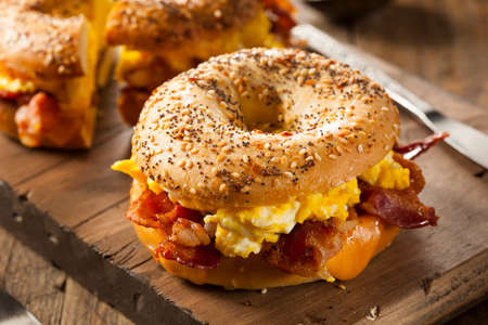 fried food: Hearty Breakfast Sandwich on a Bagel with Egg Bacon and Cheese