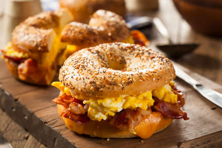 breakfast sandwich: Hearty Breakfast Sandwich on a Bagel with Egg Bacon and Cheese