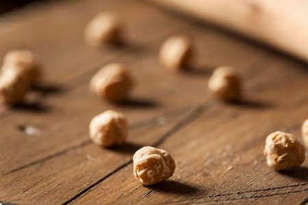 garbanzo bean: Raw Organic Garbanzo Beans in a Spoon