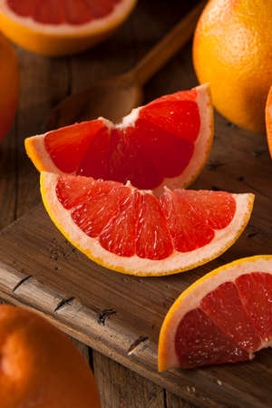 ruby red: Healthy Organic Red Ruby Grapefruit on a Background