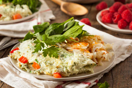 whites: Healthy Spinach Egg White Omelette with Tomatos Stock Photo