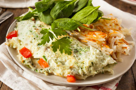 egg white: Healthy Spinach Egg White Omelette with Tomatos Stock Photo