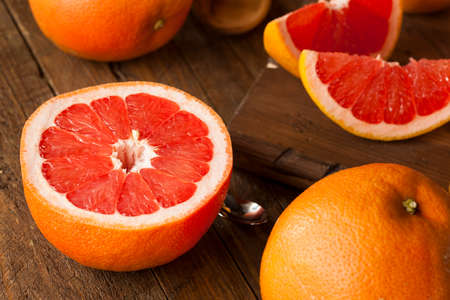sliced orange: Healthy Organic Red Ruby Grapefruit on a Background