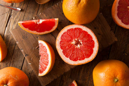 grapefruit: Healthy Organic Red Ruby Grapefruit on a Background