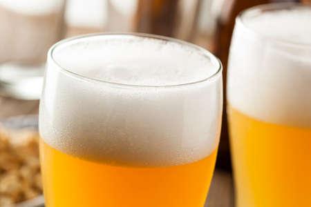 glass beer bottle: Resfreshing Golden Lager Beer in a Pint Glass