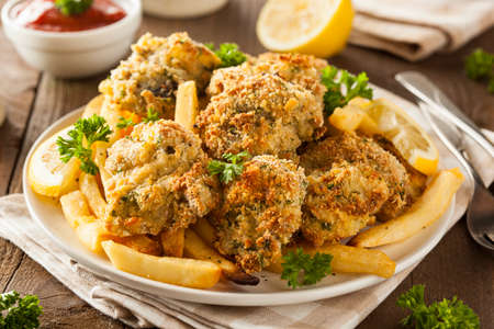seafood platter: Homemade Breaded Fried Oysters with French Fries Stock Photo