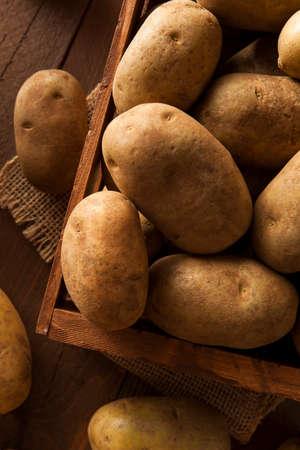 Organic Raw Brown Potatoes in a Basket 写真素材